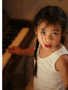 Child Seated on Piano Bench
